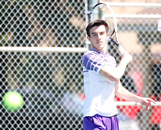 Watertown's Sam Mahowald follows through after smacking a forehand return Friday during a high school boys tennis triangular at Mitchell.
