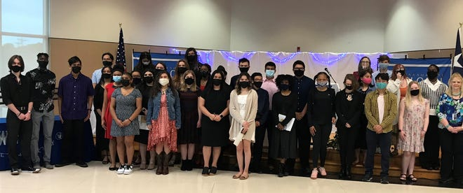 At Global High School, 29 students were recently inducted into the National Honor Society during a ceremony.