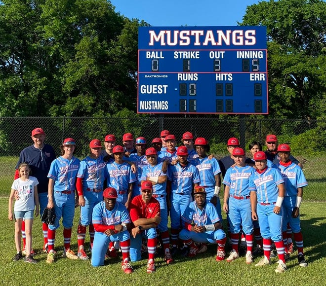The Life Waxahachie Mustangs pose for a photo after they routed Dallas Pinkston, 11-0, in five innings in a one-game Class 4A Region II bi-district playoff on Thursday.