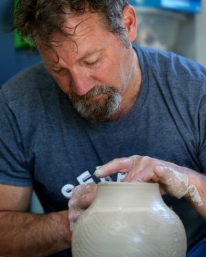 Jeff Adams of ANJL Ceramics carefully shapes his vase while throwing at his North Scituate studio on Friday, May 7, 2021.