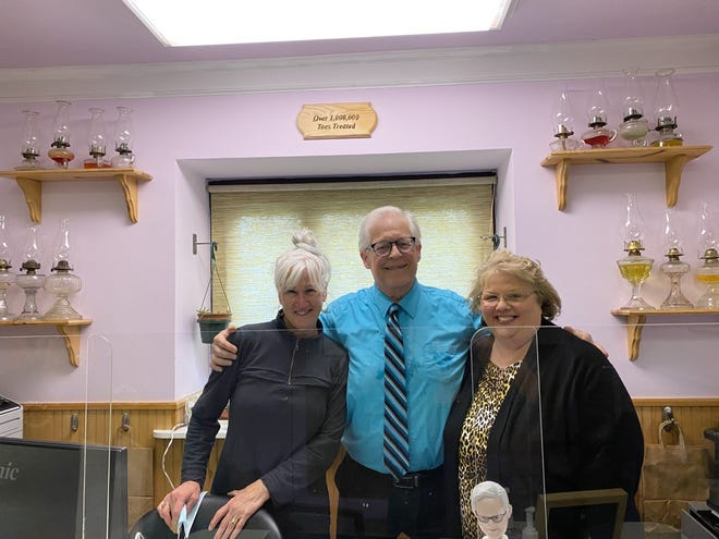 Dr. David Alper with his office assistants, Linda Atherton (left) who worked for him for16 years, and Susan Mulvaney who worked for him for five years.