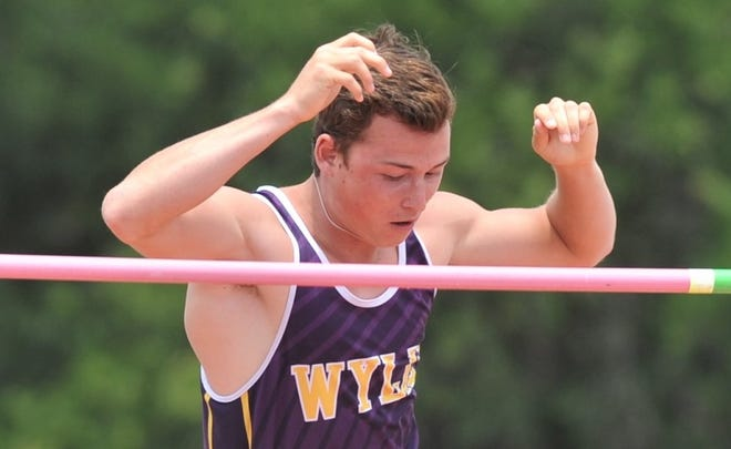 Wylie's Kylor Aguilar clears the bar at 15-3 in the Class 5A pole vault at the state meet Friday in Austin. He won the event with a 15-9.