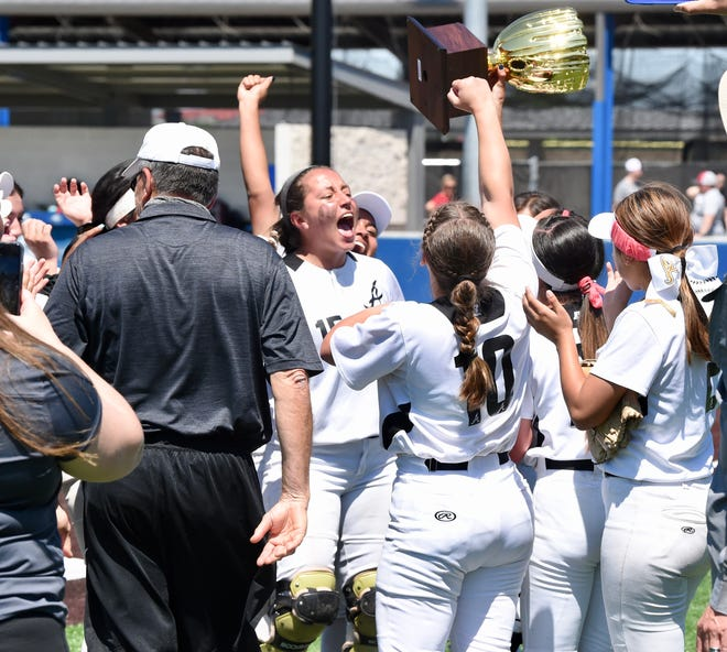 The Abilene High softball team celebrates with the area championship trophy after beating Euless Trinity in Friday's one-game area playoff at Weatherford on May 7, 2021. The Lady Eagles won 4-2 to advance to the Region I-6A quarterfinals.
