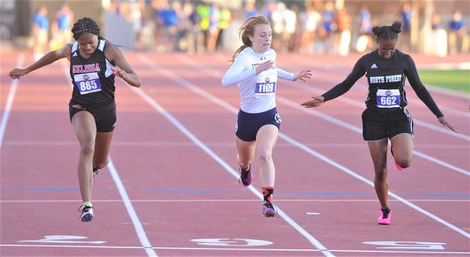 Melissa's Kaylee Lewis, left, Stephenville's Victoria Cameron, center, and Houston North Forest's Patris Mathis finish 1-2-3 in the Class 4A girls' 200 meters at the state track and field meet Thursday at Mike A. Myers Stadium in Austin. Cameron beat out Lewis for the 100 title earlier in the day.
