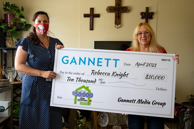 Caller-Times Editor Mary Ann Cavazos Beckett presents Corpus Christi resident Rebecca Knight with a $10,000 check. Knight was among the winners of Gannett's Home Makeover sweepstakes.