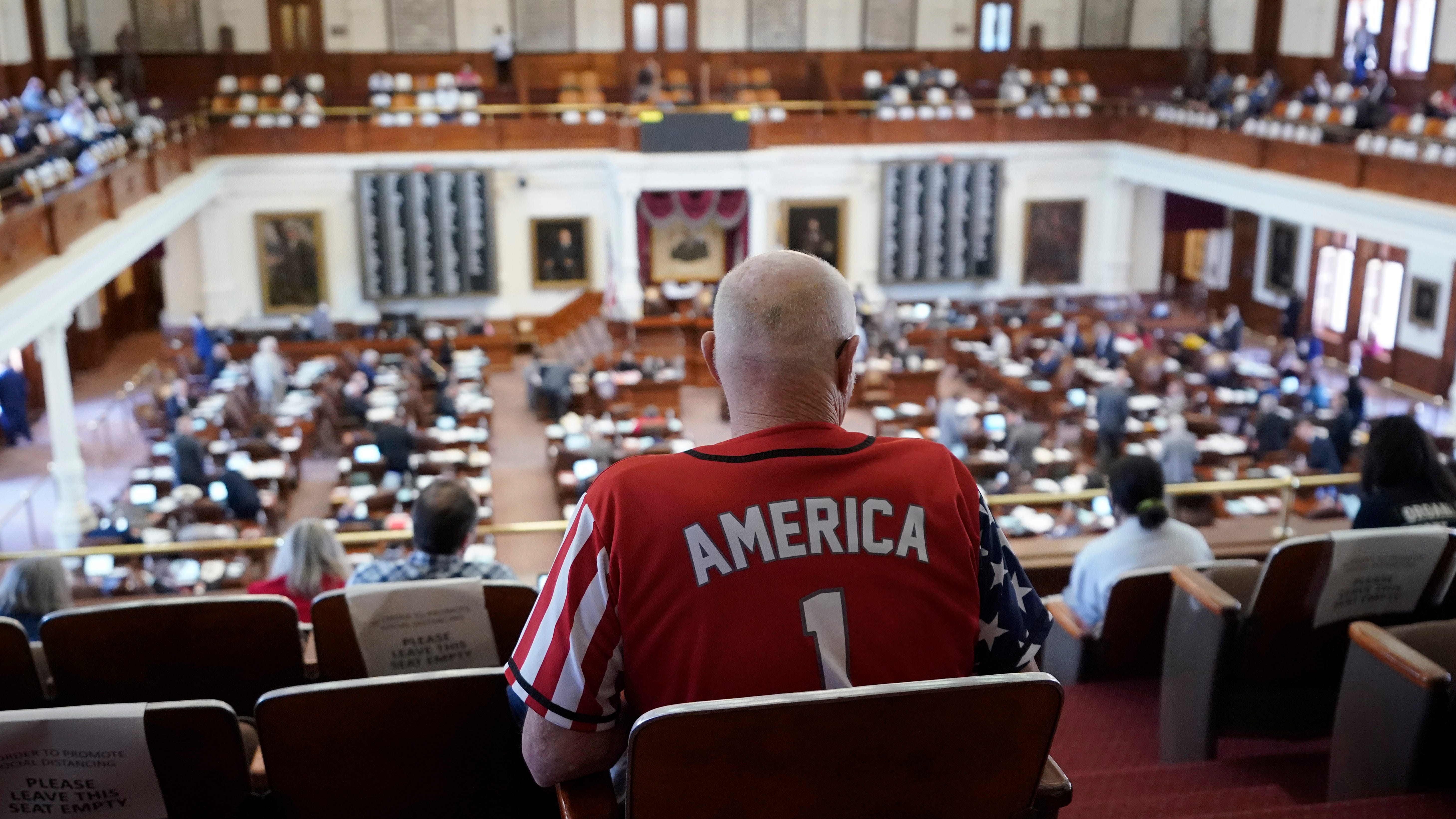 Gerald Welty sits the House Chamber at the Texas Capitol as he waits to hear debate on voter legislation in Austin, Texas, Thursday.
