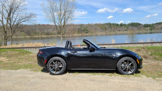 Topless. The 2020 Mazda MX-5 Miata is a roadster with a soft top that can be easily stuffed behind the rear seats without stepping out of the car.