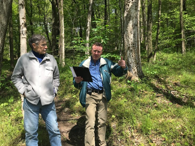 Dan Hardwick, at right, spokesman for the North Central Ohio Land Conservancy, along with Eric Miller, a trustee of NCOLC, held a press conference Friday to share information about a bill state Sen. Mark Romanchuk is introducing to make the 120-acre Doris Duke Woods a state nature preserve at Malabar Farm State Park and prohibit the removal of timber. The press conference was held near Ohio 95.
