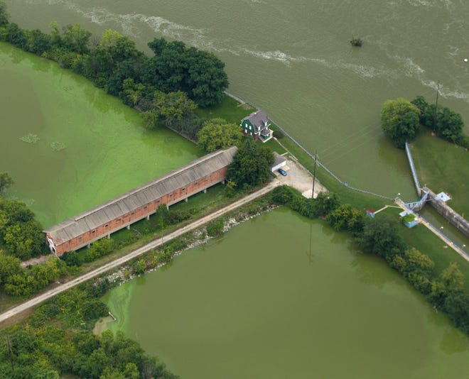 Algae blooms are shown Aug. 28, 2014, near the Little Kaukauna Lock and Dam on the Fox River south of DePere.