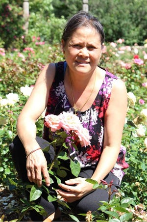 Pa Her Yang, 57, was the rock of her family of 10 children, ages 20 to 40, and her husband. She died from COVID-19 on Jan. 18.