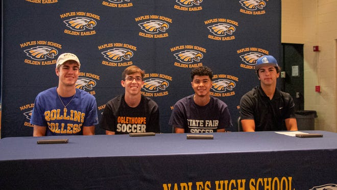 From left, basketball player James Cone (crew, Rollins College), boys soccer players Stephen Bole (Oglethorpe) and Andry Salazar (State Fair Community College) and baseball player Carson Fellows (Lakeland Community College) signed letters of intent during a signing ceremony at Naples High School on Friday, May 7, 2021.