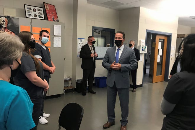 Lt. Gov. Jon Husted talks with Gayle Cromin, medical assisting instructor, and students during his Wednesday tour of the school.