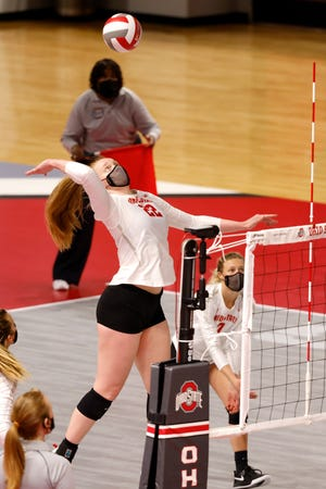 Ohio State freshman Emily Londot from Utica goes high above the net for a kill against Purdue at the Covelli Center. Londot was named Big Ten and National Freshman of the Year, and made second-team All-America.