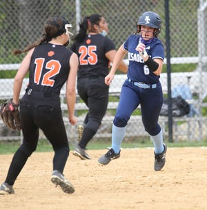 Alex Eckerson runs to second as Morris Catholic played Dover in Softball in Dover on May 7, 2021.