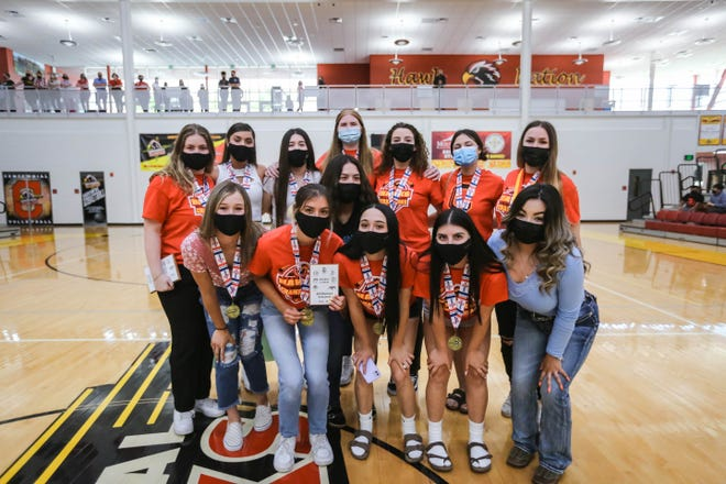 The Centennial volleyball team receives medals and plaques at Centennial High School in Las Cruces on Friday, May 7, 2021, after winning the 5A state championship.