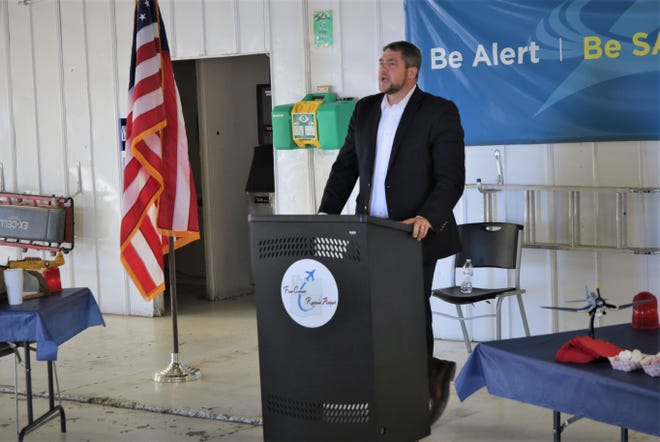 Ryan Waguespack, senior vice president of the National Air Transportation Association, addresses a small crowd in an Atlantic Aviation hangar at Farmington's Four Corners Regional Airport on May 6, 2021.