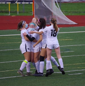 South Lyon East girls soccer remains undefeated after nine games played in 2021.