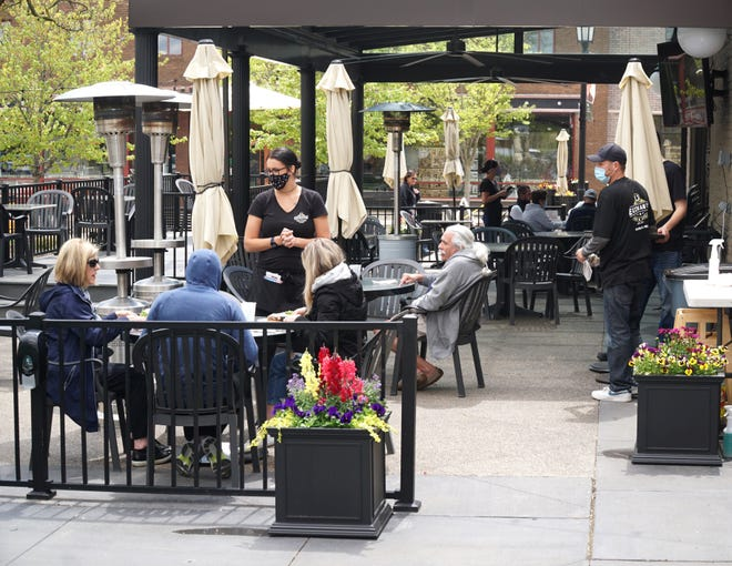 Lunch-time diners at Northville's The Exchange Bar & Grill enjoy a meal outside on May 7, 2021.
