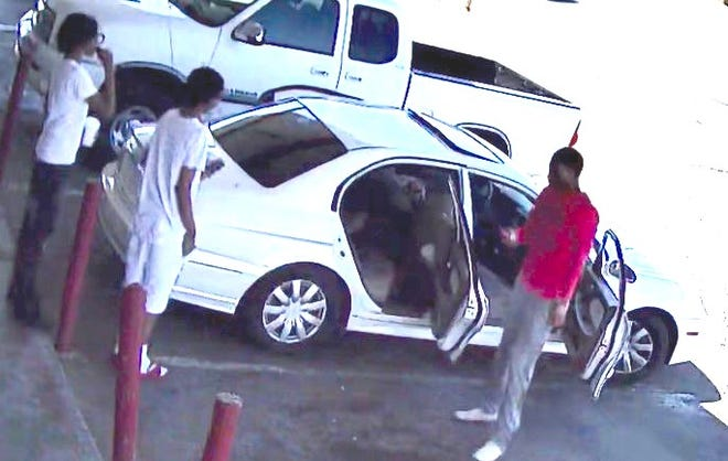 FBI are looking for the individuals that got into this car 10 minutes prior to the drive-by shooting.