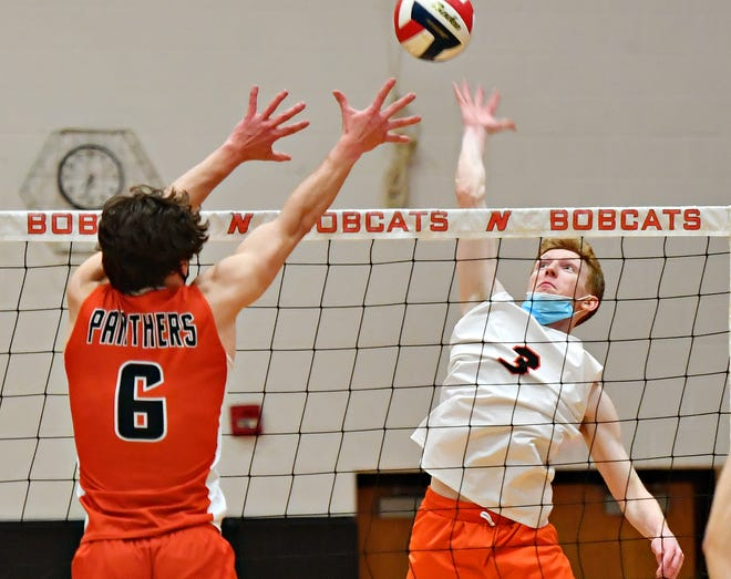 Northeastern's Brian Warrender, right, hits the ball across the net while Central York's Johnny Krentz defends during boys' volleyball action at Northeastern High School in Manchester, Thursday, May 6, 2021. Northeastern would win the game 3-0. Dawn J. Sagert photo