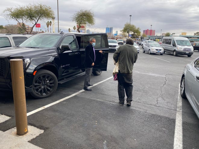 Dave Marlon, the cofounder of Vegas Stronger, helps transport a man experiencing homelessness.