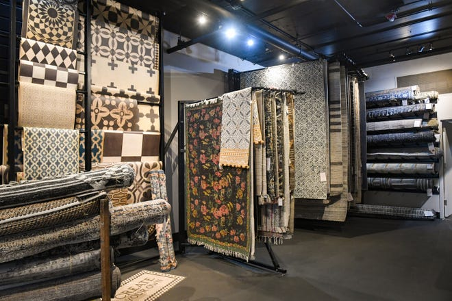 Rug racks fill an area of the newly expanded showroom on Thursday, May 7, 2021, at Simply Perfect in Sioux Falls.