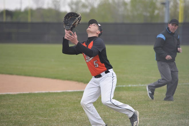 Tech's Jaden Mendel catches a fly ball in foul territory against Alexandria at Tech High School on Thursday, May 6, 2021.