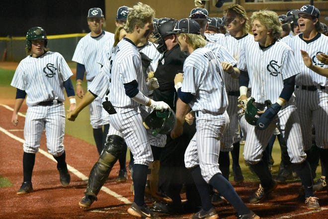 Landon Frei celebrates with his Snow Canyon teammates hitting a walk-off three-run home run in a run-rule win over Dixie that clinched a share of the Region 9 title.