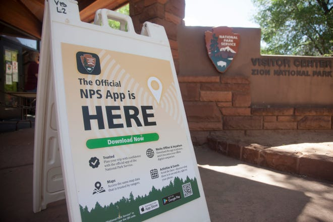 Zion National Park visitors discuss the new National Park Service app Thursday, May 6, 2021.