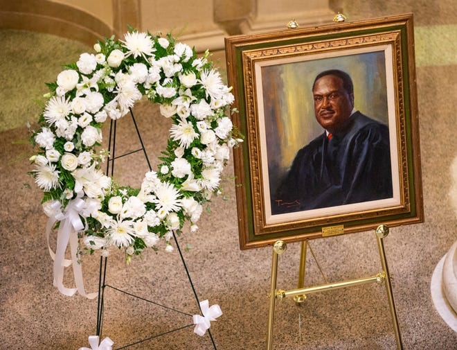 The late Florida Supreme Court Justice Joseph W. Hatchett lies in state Friday, May 6, 2021.
