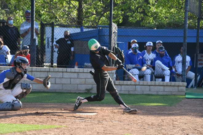 Max Muncy connects for a grand slam in the sixth inning of Thousand Oaks High's 8-2 victory over Westlake in a Marmonte League game on Thursday, May 6, 2021. The Lancers improved to 18-0 with their 26th straight win.