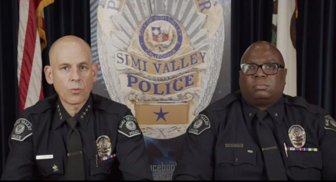 Police Chief David Livingstone (left) and Cmdr. Steve Shorts of the Simi Valley Police Department answer questions about hate crime investigations during a public forum on Thursday night.