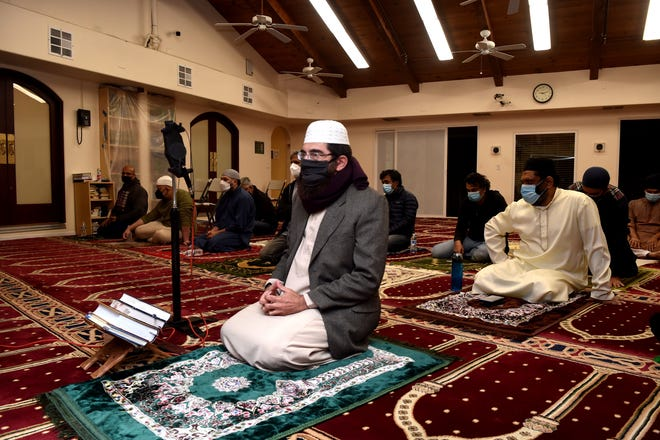 Imam Muhammed Shoayb Mehtar prepares to participate in prayer as members of the Islamic Center of Conejo Valley observe Ramadan on Thursday, May 6, 2021. Ramadan, celebrated by Muslims, is a month of fasting, prayers and community gatherings culminating in Eid al-Fitr on Wednesday, May 12, 2021.