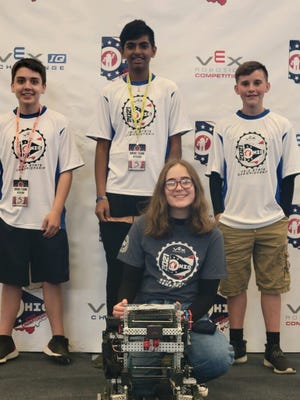 The Zanesville Middle School robotics team brought home the state title and qualified for international competition at a recent tournament. Karter Bludnick, Dhruv Patel, Caiden Balsley and Chloe Buchanan are pictured with their robot at the state tournament.