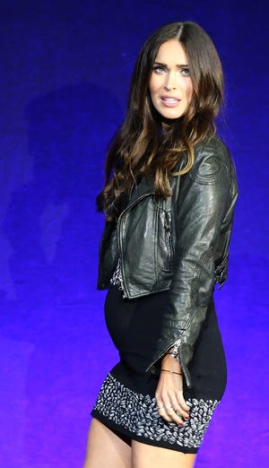 Megan Fox is speaking out about how moms are treated in Hollywood. This photo shows her rocking her baby bump in 2016 at CinemaCon.