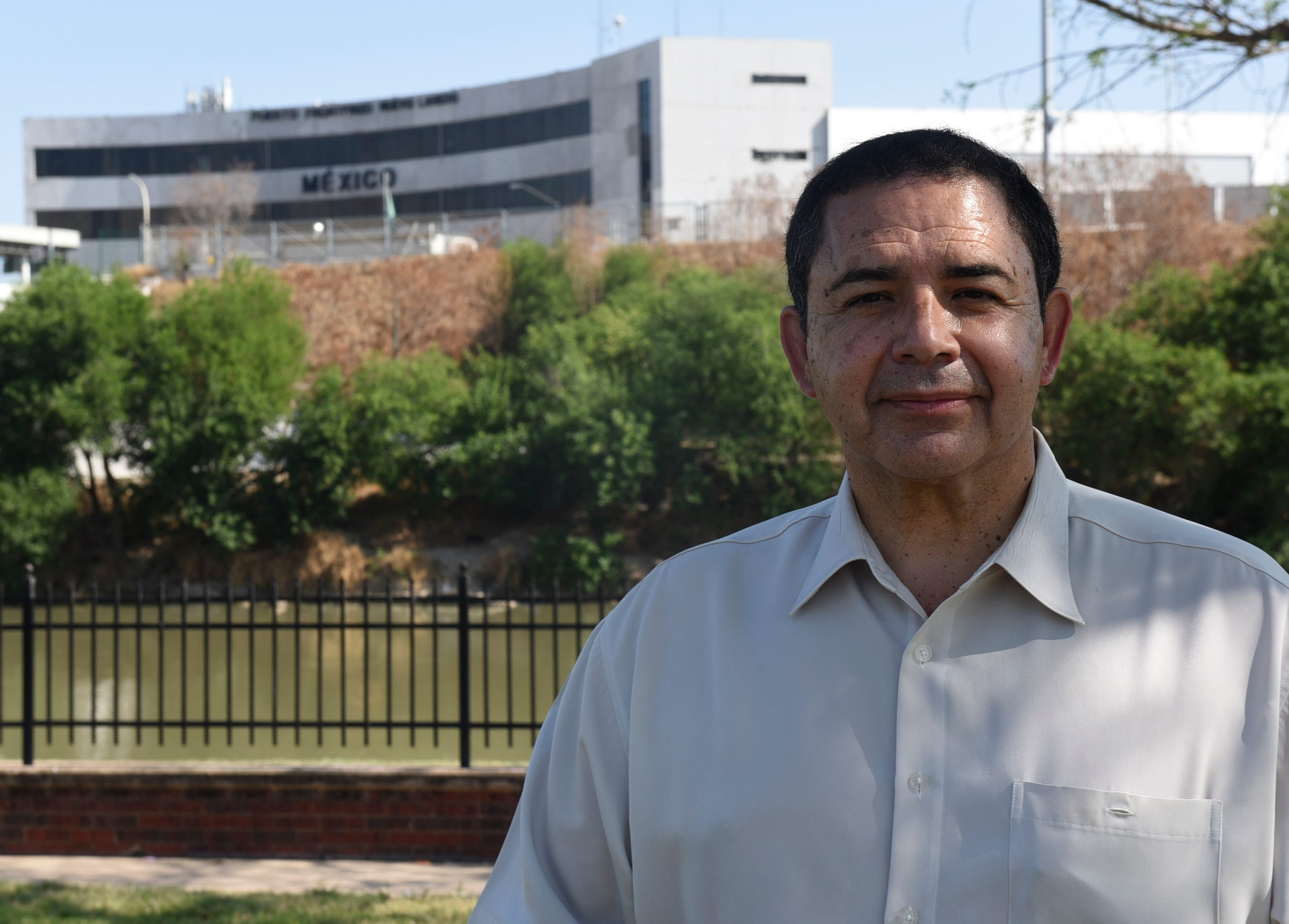 Rep. Henry Cuellar, D-Texas, stands in front of the Rio Grande River and U.S.-Mexico border April 8, 2021, in Laredo, Texas.