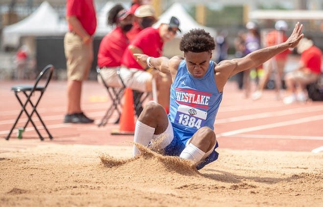 Westlake sophomore Ashton Torns lands after soaring to a gold medal in the Class 6A long jump at the state track and field meet Saturday at Myers Stadium.
