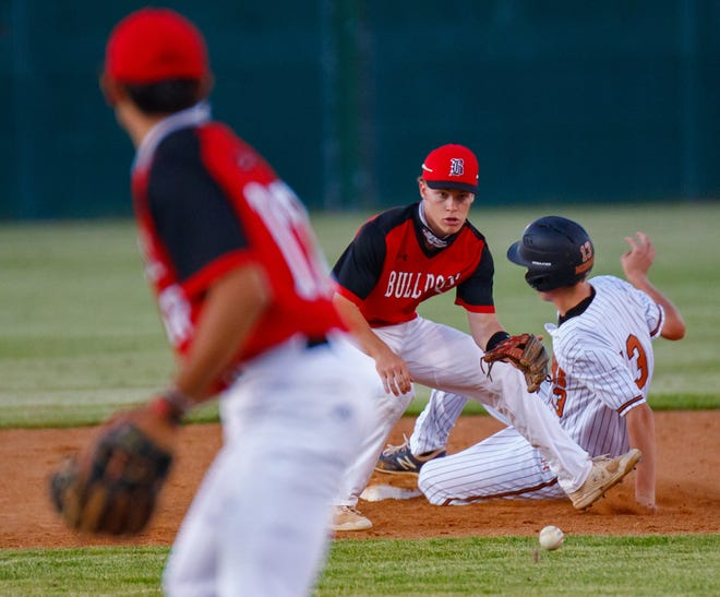 Westwood's Cooper Williamsom  slides safely into second base on a steal as Bowie's Mayson Winters  tries to lay down the tag during the third inning at the first game of a Class 6A bi-district baseball game on Thursday at Westwood High School. Bowie won the first game but Westwood evened the series at 1-1 on Friday to set up Saturday's decisive game three.