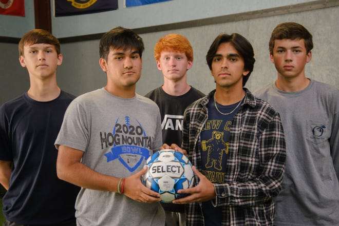 From left to right: Charlie Burke, Gabe Valdez, Ashton Davis-Ayers, Daniel Castro and JP Dew pose for a portrait on Friday, May 7, 2021 at Core Blend Training and Wellness in Watkinsville, Georgia. The Oconee County boys soccer team defeated Pike County in a penalty kick shoot-out to advance to the semifinals against Westminster. (Julian Alexander for the Athens Banner-Herald)