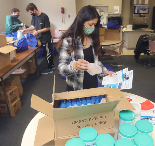 University of Akron golfer Ivana Shah packs COVID-19 relief kits at the Cleveland Clinic Akron General's Bellows Building on May 8 in Akron. Shah has won the prestigious Dinah Shore Trophy Award.