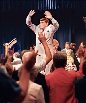 The Rev. Ernest Angley leads a service at the Cathedral of Tomorrow in June 1999.