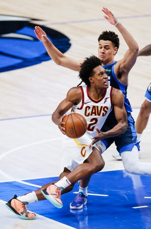 Guard Collin Sexton (2) said being better at making passes on time and on target will help the Cavaliers improve their production from behind the 3-point arc. [Brandon Wade/Associated Press]