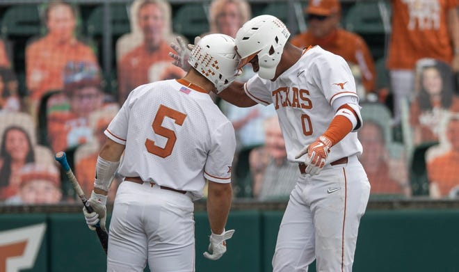 """Texas shortstop Trey Faltine, right, and outfielder Mike Antico celebrate a run scored against Texas Tech during their game in late April at UFCU Disch-Falk Field. """"He finds a lot of ways to get on base and creates a lot of havoc,"""" Faltine said.""""Hecan do a lot for us and obviously him being in the outfield as well helps."""""""