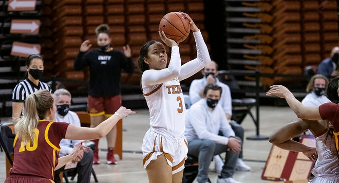 Texas guard Karisma Ortiz (3) gets a shot off as Iowa State Kylie Feuerbach (10) tries to defend in Austin on Jan. 3, 2021. After two years at Texas, Ortiz will transfer to Cal.