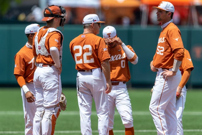 Texas head coach David Pierce speaks with his team on the mound during an NCAA baseball game against Texas Tech at UFCU Disch-Falk Field in Austin, Sunday, May, 2, 2021.