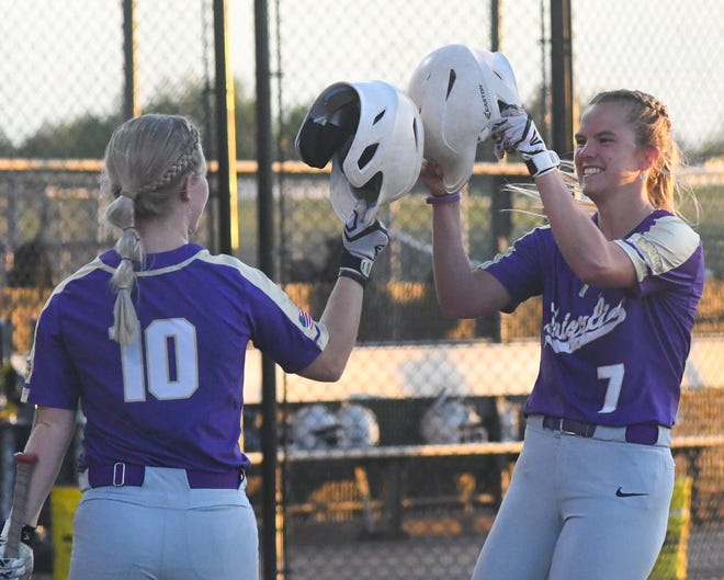 Butler's Gentry Shepherd (7) celebrates with McKenna Jones (10) after hitting a solo home run during the Grizzlies' 12-1 victory over Dodge City in Friday's Region VI opening round at Legends Park in Dodge City, Kansas.