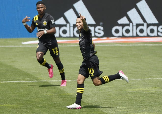 Midfielder Lucas Zelarayan (10) celebrates his goal off a free kick during the 20th minute to give the Crew a 1-0 lead against D.C. United at Crew Stadium.