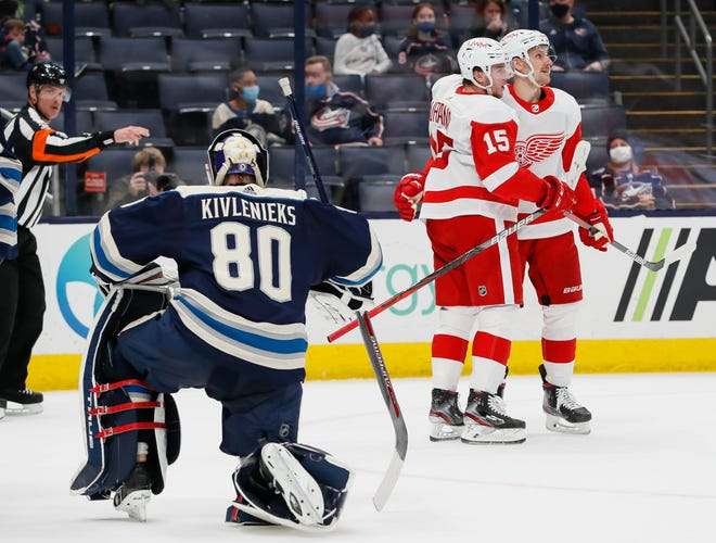Detroit Red Wings left wing Jakub Vrana (15) celebrates scoring a goal with right wing Richard Panik (24) in front of Columbus Blue Jackets goaltender Matiss Kivlenieks (80) during the second period of the NHL hockey game at Nationwide Arena in Columbus on Friday, May 7, 2021.