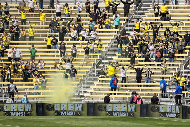 Columbus Crew SC fans celebrate the 3-1 win over D.C. United following the MLS game at Historic Crew Stadium in Columbus on Saturday, May 8, 2021.