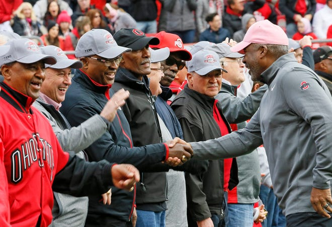 Ohio State athletic director Gene Smith, here greeting members of OSU's 1968 national championship football team in a 2018 ceremony, said his mother, Elizabeth, taught him to respect everyone he encounters, regardless of their circumstances.